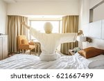 a young man waking up in bed... | Shutterstock . vector #621667499