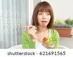 woman eating salad | Shutterstock . vector #621691565