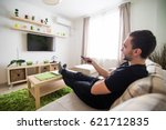 young handsome man watching... | Shutterstock . vector #621712835