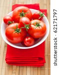fresh tomatoes on red napkin - stock photo