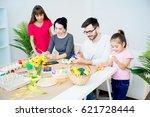family painting eggs | Shutterstock . vector #621728444