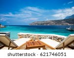 sun lounger and umbrella on the ... | Shutterstock . vector #621746051