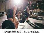 strong muscular people lifting... | Shutterstock . vector #621761339