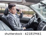 businessman driving car and...   Shutterstock . vector #621819461