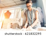 Young Dressmaker Woman Sews...