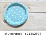 A Light Blue Paper Plate With...