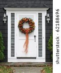 autumn wreath on door - stock photo