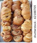 display of croissants and baked goods - stock photo