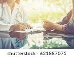 women doctors and patient are... | Shutterstock . vector #621887075