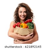 young woman holding grocery... | Shutterstock . vector #621892145