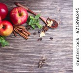 red apples  cinnamon sticks and ... | Shutterstock . vector #621896345