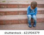unhappy little caucasian child... | Shutterstock . vector #621904379