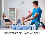 man husband ironing at home... | Shutterstock . vector #621932261