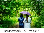 mother and daughter walking in... | Shutterstock . vector #621955514