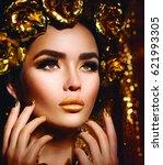 gold woman holiday makeup.... | Shutterstock . vector #621993305