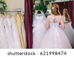 female trying on wedding dress... | Shutterstock . vector #621998474