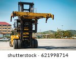Forklift Truck On Shipping Yard....