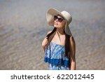 girl in sunglasses on the beach | Shutterstock . vector #622012445