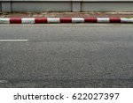 concrete sidewalk with red and... | Shutterstock . vector #622027397