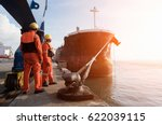 Small photo of mooring gang in port to departure ship