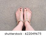 close up of bare feet with... | Shutterstock . vector #622049675