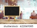 blackboard menu with easel on... | Shutterstock . vector #622069385