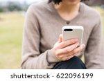 woman holding a smartphone | Shutterstock . vector #622096199