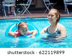 mother teaches children to swim. | Shutterstock . vector #622119899