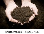 brown  land and humman hand  on ... | Shutterstock . vector #62213716
