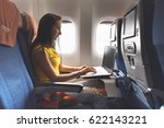 woman using laptop while is... | Shutterstock . vector #622143221