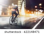 Cyclists Ride Through Lighted...