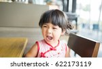 angry and hungry little asian... | Shutterstock . vector #622173119