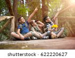 young scouts sitting on old... | Shutterstock . vector #622220627