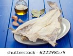 Small photo of salted cod fish on wooden background