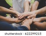 business teamwork join hands... | Shutterstock . vector #622299215