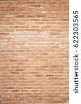 Small photo of Orange brick wall. Brick wall texture pattern or brick wall background