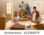 young women opening boxes with... | Shutterstock . vector #622368479