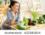 young and happy woman eating... | Shutterstock . vector #622381814