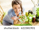 young and happy woman eating... | Shutterstock . vector #622381901