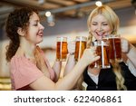 two smiling women clang glass... | Shutterstock . vector #622406861