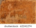 Wild mustang horses montaged on an old worn leather background - stock photo