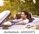 young asian couple riding in a... | Shutterstock . vector #622422371