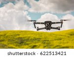 Drone flying during the day in field of flowers