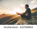 man meditating yoga lotus pose... | Shutterstock . vector #622568861