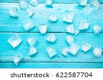 Many Cold Ice Cubes On Blue...