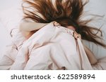 tired woman in bed | Shutterstock . vector #622589894
