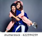 fashion portrait of two smiling ... | Shutterstock . vector #622594259