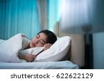 asian woman sleeping in a bed... | Shutterstock . vector #622622129