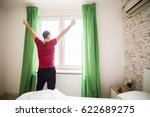 lazy man waking up in the bed... | Shutterstock . vector #622689275