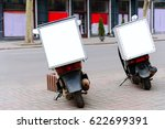 mopeds parked on the roadside ... | Shutterstock . vector #622699391